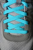 Detail of blueshoe laces on running shoes