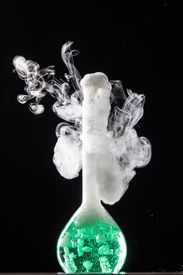pic of chemical reaction  - Chemical reaction in volumetric flask glass in labolatory  - JPG