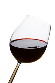 stock photo of red wine  - Red wine glass on isolated white background - JPG