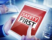foto of workplace safety  - Hands Holding Digital Tablet Safety First - JPG