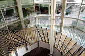foto of spiral staircase  - Spiral staircase in the big modern hotel - JPG