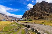 stock photo of jammu kashmir  - Sceneic view of Drass village with blue cloudy sky background Kargil Ladakh Jammu and Kashmir India - JPG