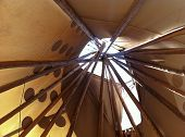 image of aborigines  - Interior view of an Aboriginal Tee Pee with lodge poles orientated up to the sky - JPG
