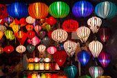 stock photo of handicrafts  - Handicraft colorful lamps illuminated at night - JPG