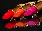 image of lipstick  - 3 Lipsticks on black background with mirror - JPG