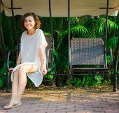stock photo of swingset  - Woman sitting on the swingset - JPG