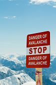 foto of avalanche  - Avalanche sign and mountains at the background - JPG