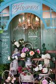 picture of flower shop  - shelves with basket of flowers in a flower shop - JPG