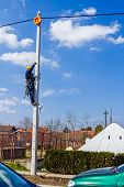 pic of utility pole  - Electric worker is climbing up on a pole - JPG