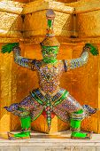 foto of demons  - Demon mythical creature guarding the Golden Stupa also known as Phra Sri Ratana Chedi  - JPG