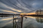 stock photo of dock a pond  - Evening scene after sunset on a pond with pier - JPG