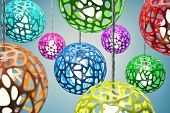 picture of chandelier  - Chandeliers of different colour hang on a wire - JPG
