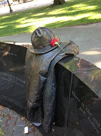 stock photo of firefighter  - A sculpture dedicated to firefighters dead in the worst firefighting tragedy in Boston - JPG