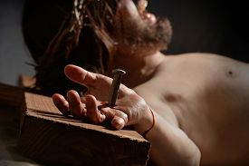 pic of calvary  - Jesus  on the cross with nail and hand in foreground - JPG