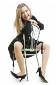 The Cheerful Woman Sits Astride A Chair