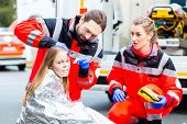 foto of accident emergency  - Emergency doctor and paramedic or ambulance team helping accident victim  - JPG