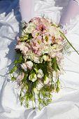 Wedding Bouquet Against A Dress