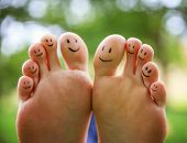 picture of big-foot  - smiley faces on a pair of feet on all ten toes  - JPG