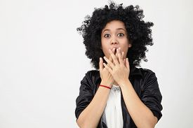 stock photo of afro hair  - Happy girl with big afro hair with surprise expression - JPG