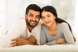 picture of married  - beautiful young indian married couple lying on bed - JPG
