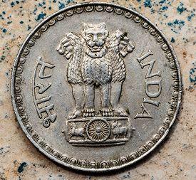 stock photo of ashoka  - ASHOKA PILLAR emblem represented in Indian coin - JPG