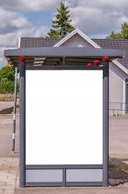 picture of bus-shelter  - An image of a bus stop with a blank bilboard for your advertising situated in the swedish town of Billesholm - JPG