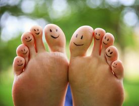 picture of human toe  - smiley faces on a pair of feet on all ten toes  - JPG