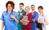 young smiley female doctor and her team. five female an male doctors