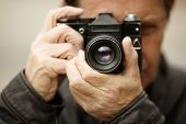 Photographer , selective focus on nearest part of the lens
