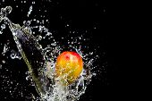 Mango Splash Over Water