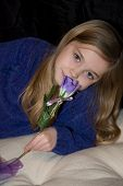 Little Girl Smelling A Rose