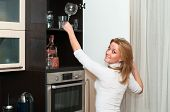 Beautiful happy smiling woman in kitchen interior