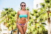 Beautiful Tanned Sexy Girl In Bikini Posing At Swimming Pool poster