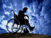 stock photo of disabled person  - Silhouette of man on a wheelchair - JPG