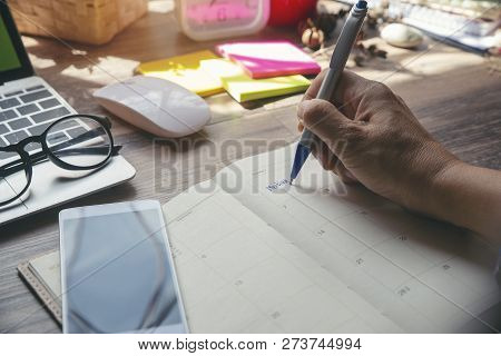 poster of On Book Or Diary,man's Hand Planner Or Organizer Writing Daily Appointment,mark And Noted Schedule(m