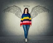 Casual Young Woman Full Length Portrait Imagining Her As A Superhero With Angel Wings And Halo Above poster