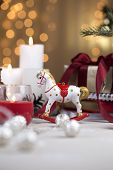 A Christmas Rocking Horse. Wooden Horse - Christmas Decoration - Background For A Greeting Card. Toy poster