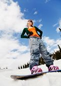 portrait of a young beautiful woman on the snowboard