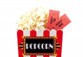 stock photo of matinee  - isolated popcorn bucket and tickets - JPG