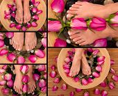 Being pampered in a spa with aromatic roses and herbal foot bath