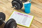 Healthy Lifestyle Concept. Mock Up On Workout And Fitness Dieting Diary. Exercise Diary Sheet, Blue  poster