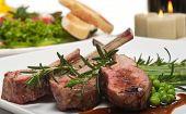 Lamb chop, salad and wine