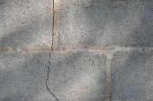 Home Wall Made Of Bricks With Cracked Crack. Broken Bricks And No Standard With Sunlight. poster