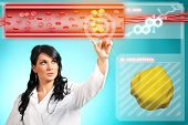 pic of lipids  - Young woman doctor working with modern interface - JPG