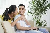 Happy Asian Man And Woman On Couch At Home With Laptop Spending Time In Chill poster