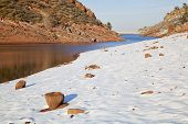 stock photo of collins  - Horsetooth Reservoir near Fort Collins Colorado in winter scenery with a dam in distant view - JPG