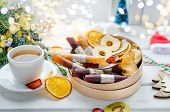 Warming Tea And Round Wooden Gift Box With Many Variety Of Dry  Fruit Chips And Fruit Leather Rolls  poster