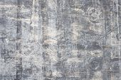 Wooden Background Of Old Cracked Grey Plywood With Cracks And Scratches poster