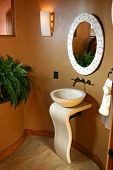 stock photo of lavabo  - Stylishly modern sink and mirror accentuate this custom washroom - JPG