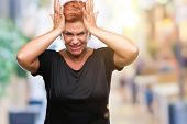 Attractive senior caucasian redhead woman over isolated background suffering from headache desperate poster
